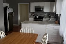 Kitchen (1st FLR)- All new appliances, complete cooking and dinning ware.