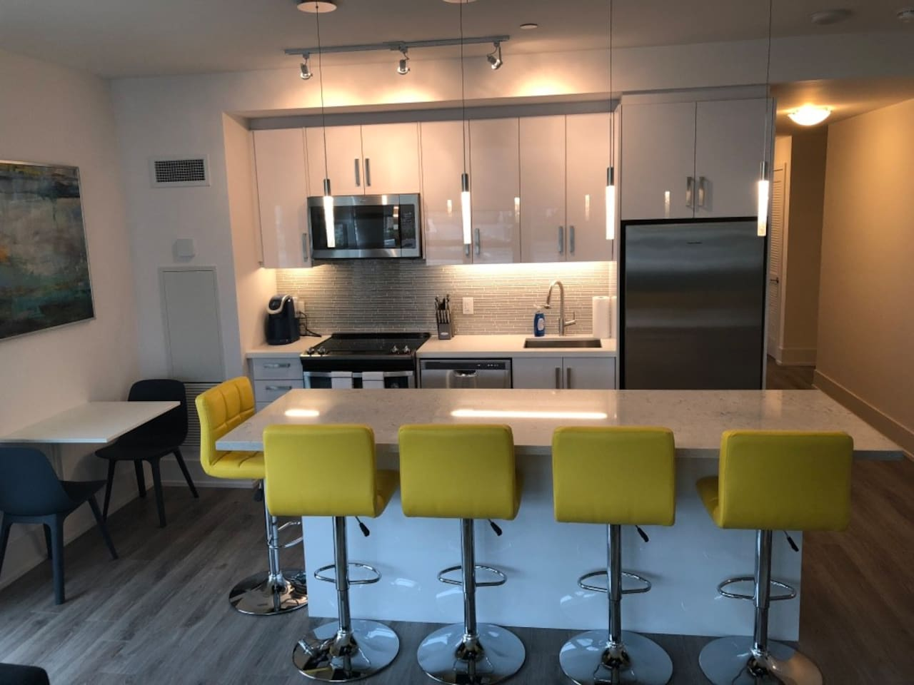 Kitchen with island and side table