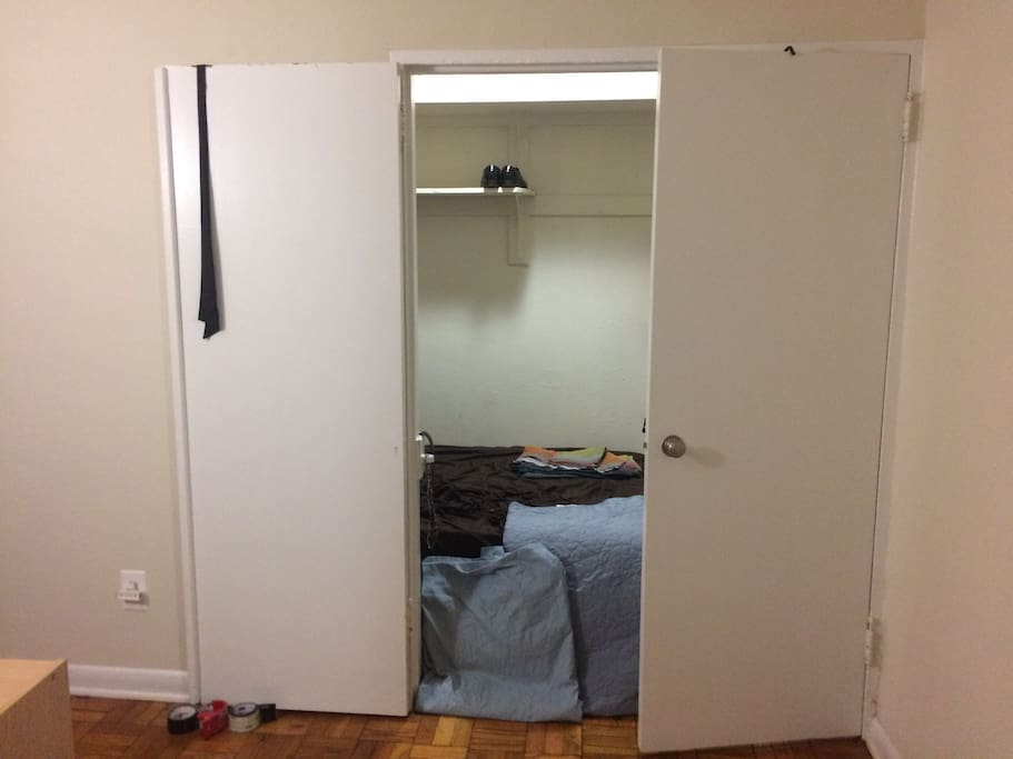 I use the walk-in closet as a sleeping alcove. The bathroom is immediately to the right.
