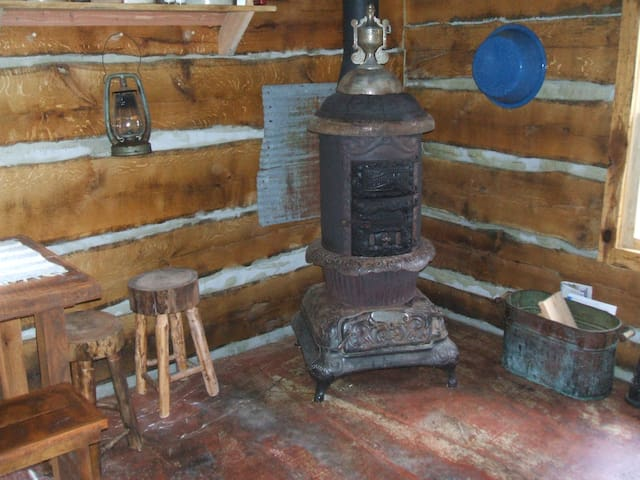 A 100 year old Round Oak stove provides heat and cooking options.
