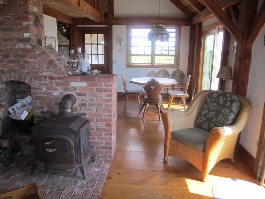 Living Room: Cozy-up with a wood-burning stove.
