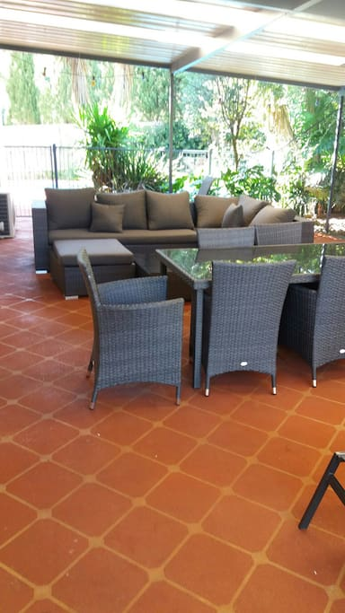 Secluded outdoor area for relaxing or dining.