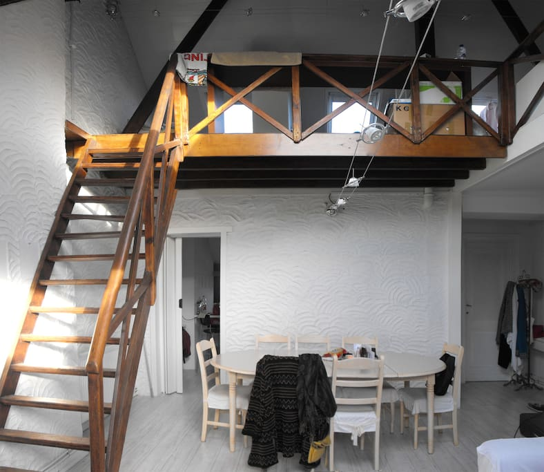 Dining area & stairs to sleeping area