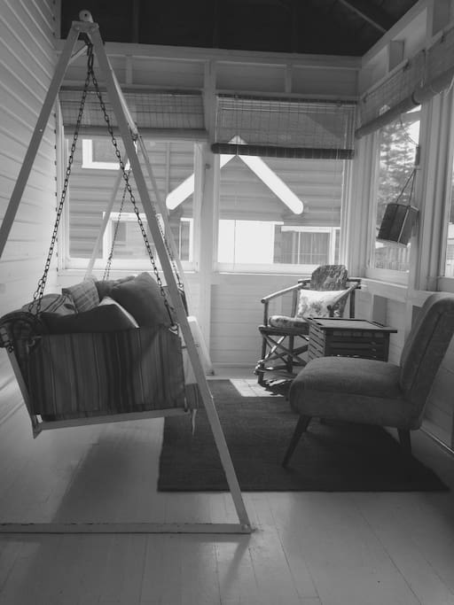 The sun porch where the porch swing is the best place to enjoy your morning coffee.