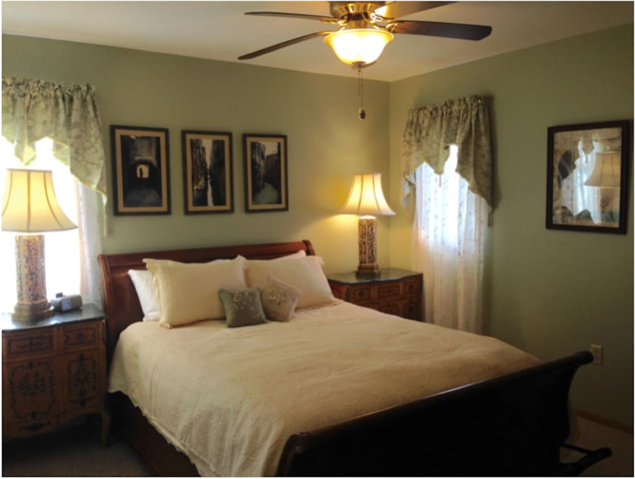 Your guest room with private bathroom adjacent. Drawers are empty for you to use. There is central air and a ceiling fan as well as an amazing mattress on this sleigh bed.