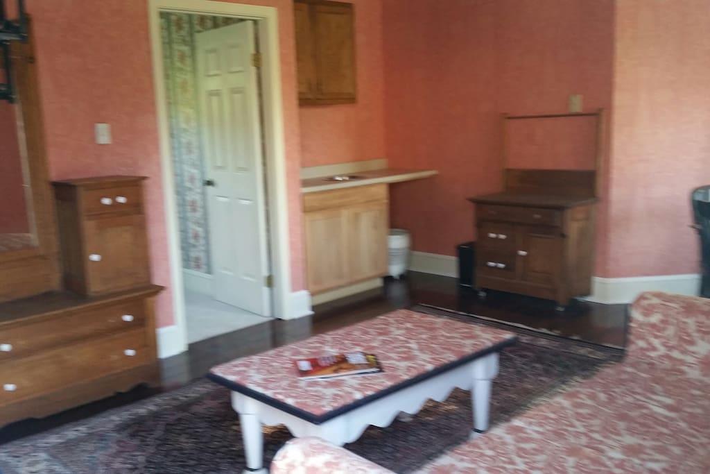 Living Room, door to bedroom and kitchenette