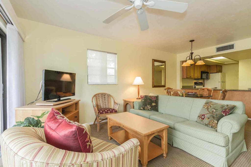 1st floor, end unit provides an abundance of light with windows in main living area (flat screen TV w/DVD player).