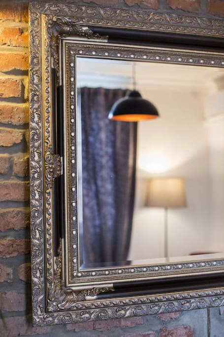 living room, mirror, detail, lamp, reflection, brick wall, curtains, vintage