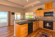 Updated kitchen with granite counter tops and new appliances