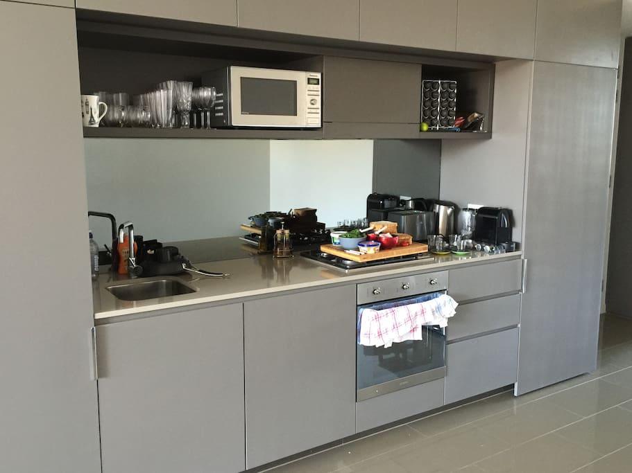 Kitchen with modern appliances including Nespresso coffee machine