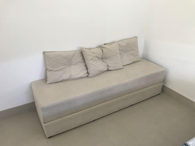 Sofá cama expansível