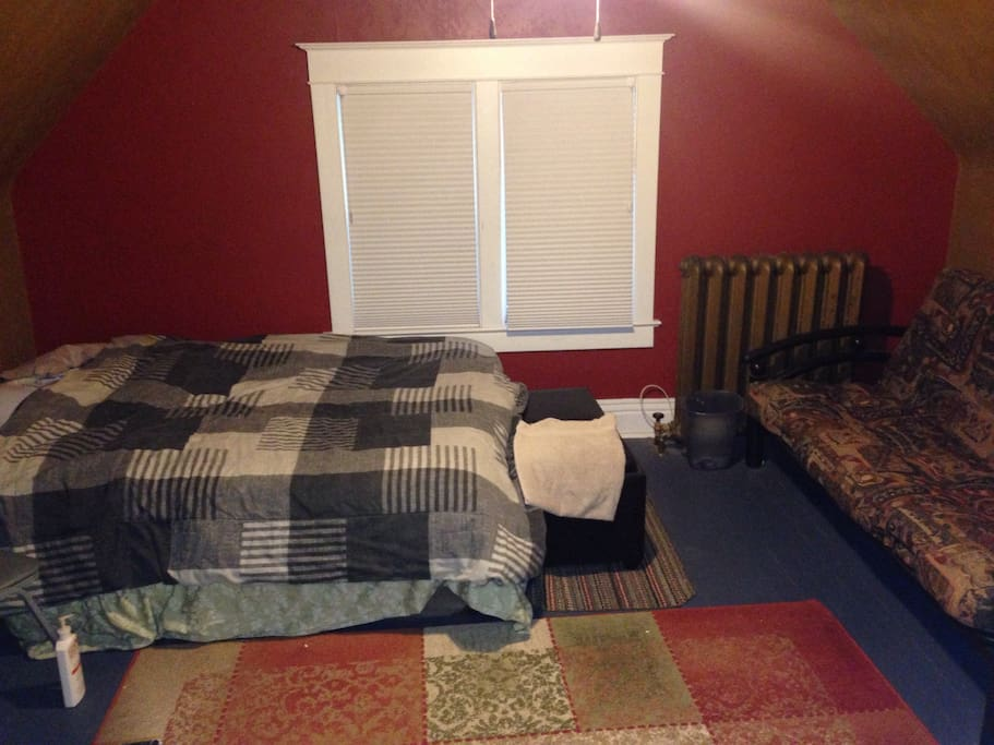 Second bedroom with a brand new queen bed and futon bed.