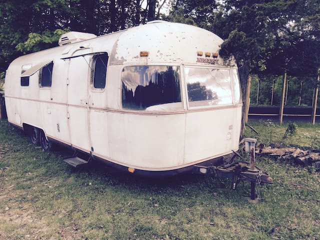 Vintage Airstream on horse farm.