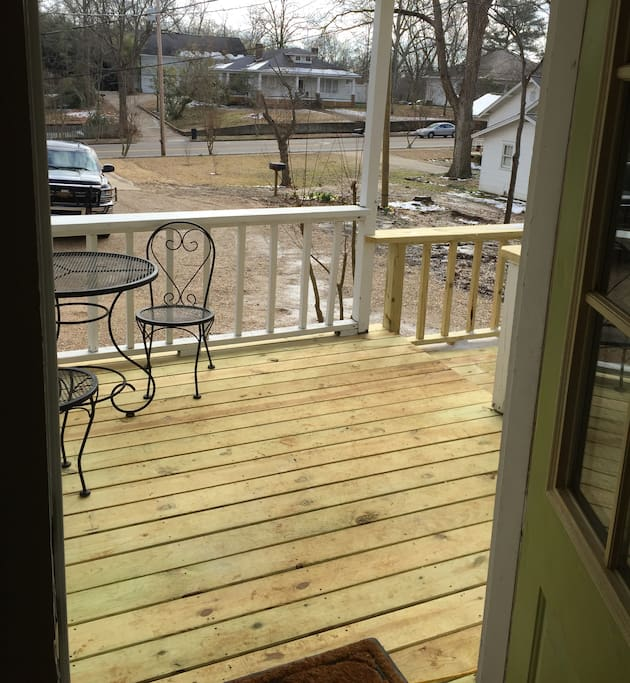 Covered porch with ceiling fan and bistro table