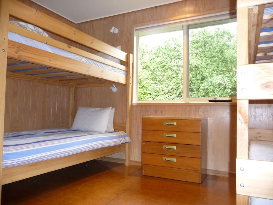 2 king single bunks with reading lamps. Large mirrored wardrobe plus TV with kids movies.