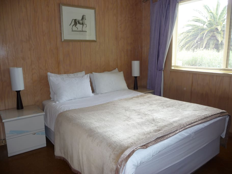 Master queen bedroom with views of Mt Buller. Large mirrored wardrobe.