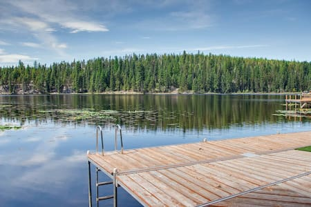 Lakefront cottage with a deck, boat access, shared dock, & amazing views!