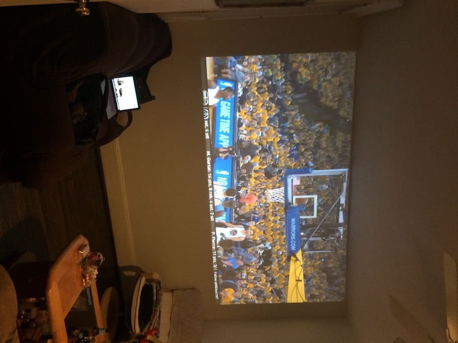 Projector in living room. Full wall screen!!