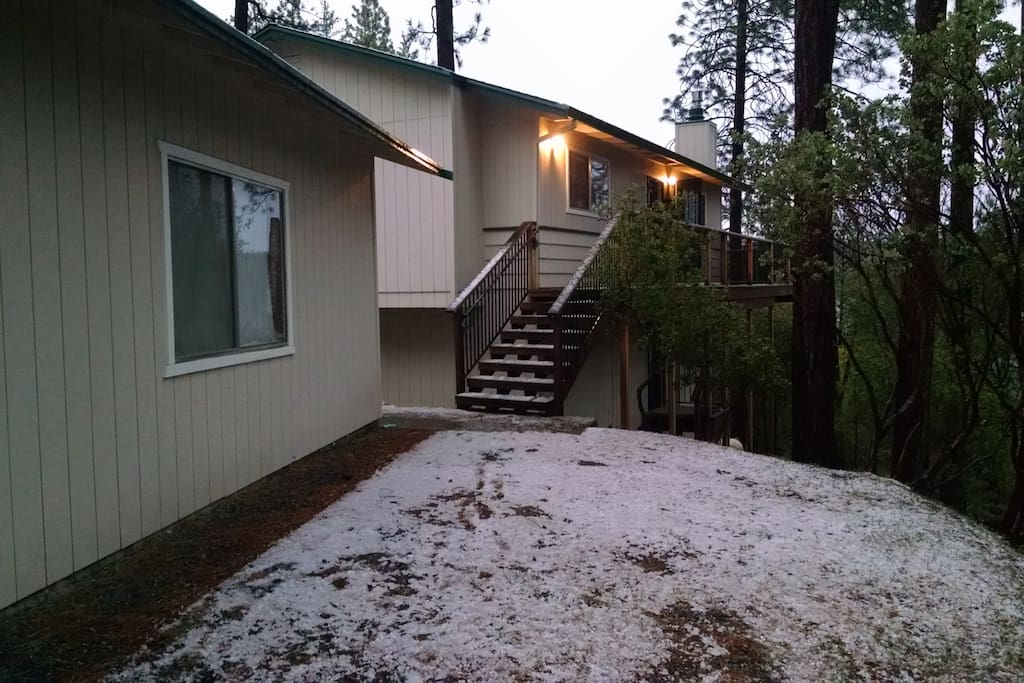 a rare dusting of snow, showing the front entrance.  Snow is no more than a few inches per year though.