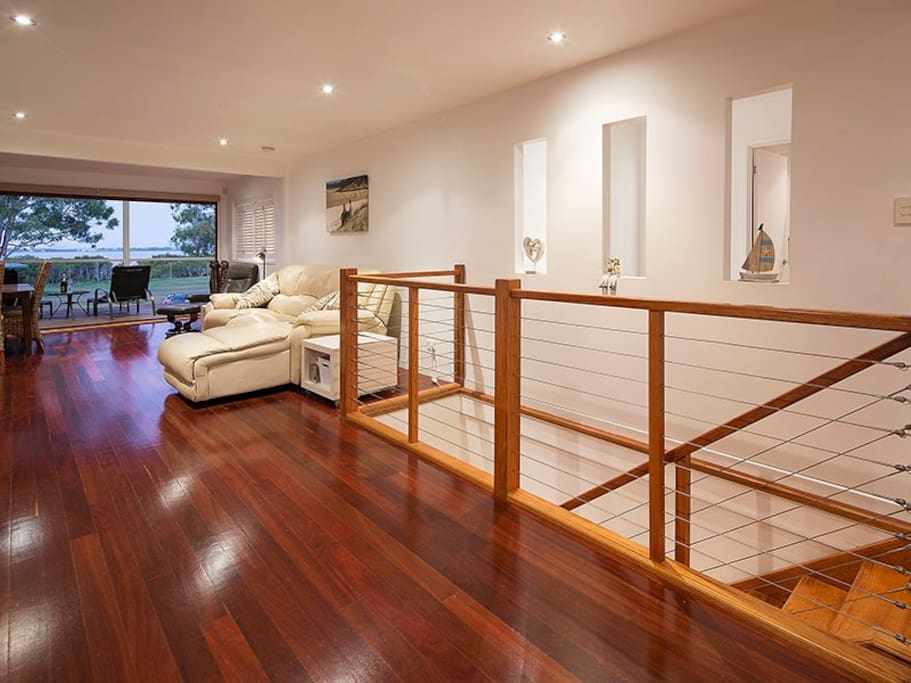Polished timber flooring to front deck