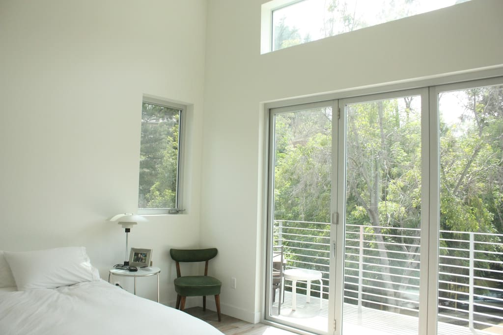 Master bedroom with full length windows to balcony.