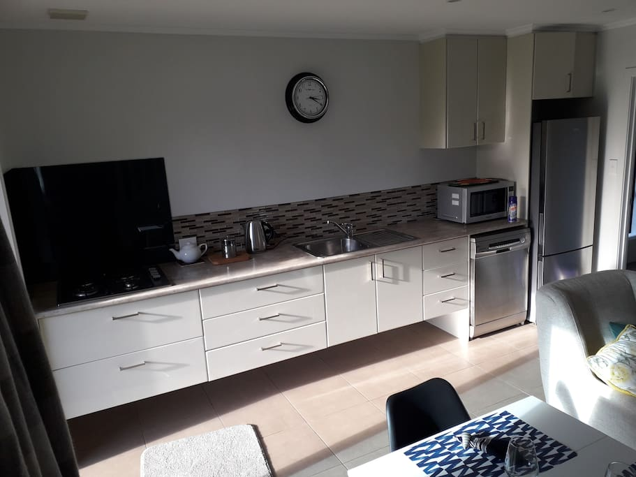 A gas cooktop, microwave oven, dishwasher and full fridge enable guests options of own cooked meals or dining out.