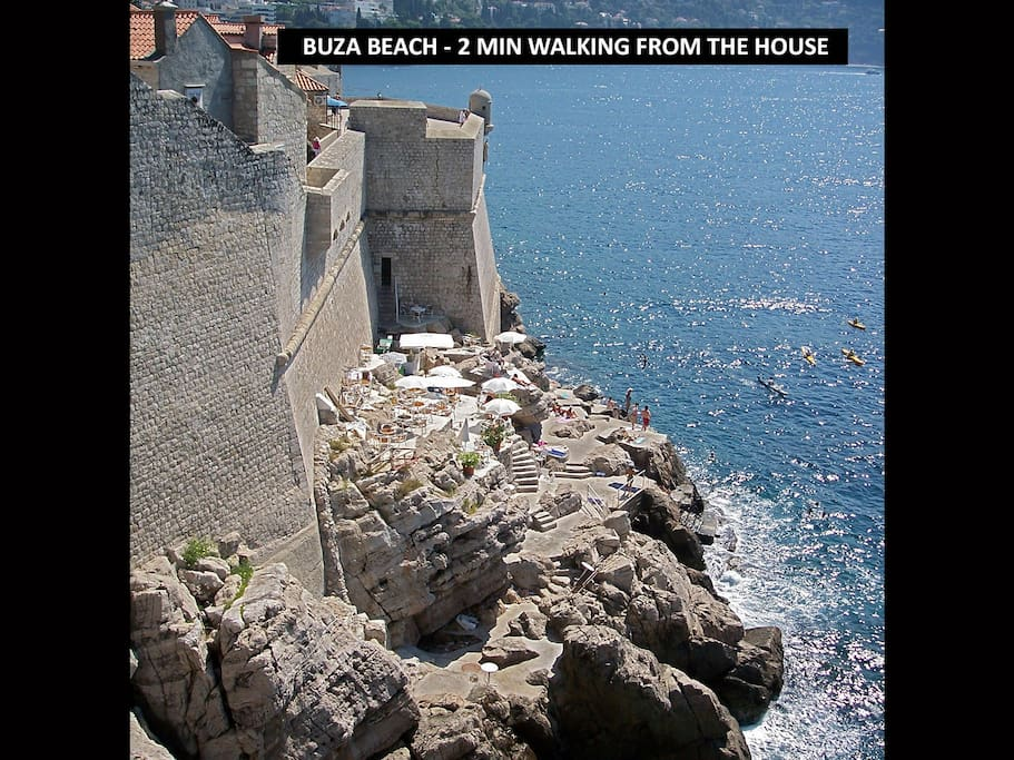 Attractive sea rocks and the summer bar beneath Dubrovnik city walls just 2 minutes from the house.