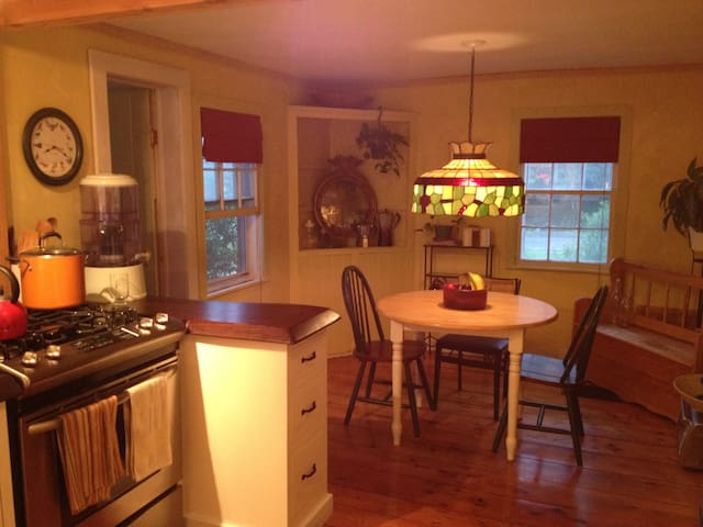 Custom designed kitchen with new appliances and original farmhouse character.