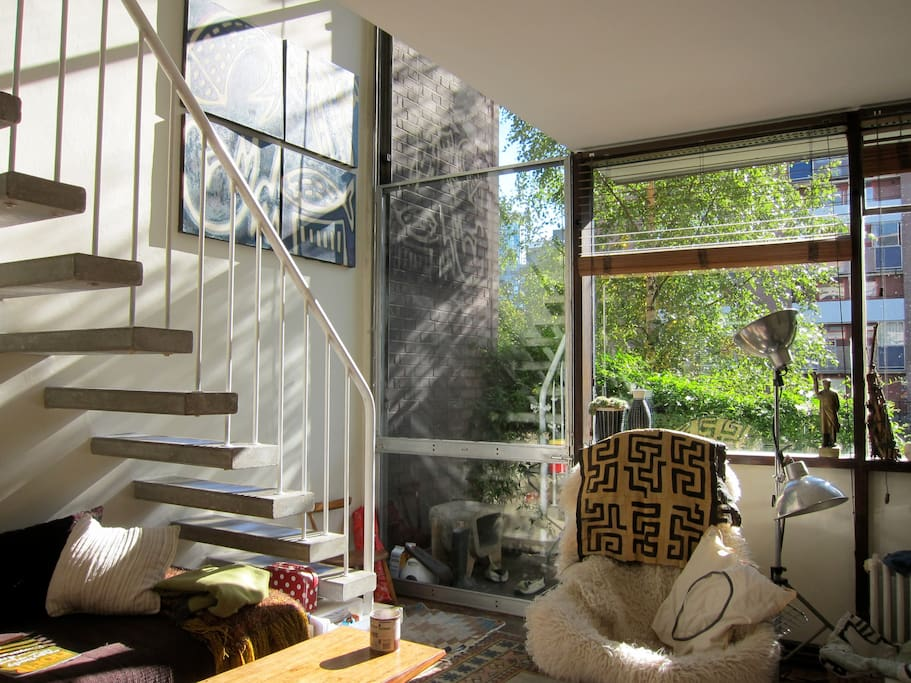 main living room with radical cantilevered concrete stair