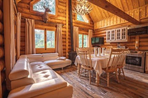 Luxueux chalet en bois rond situé en mauricie