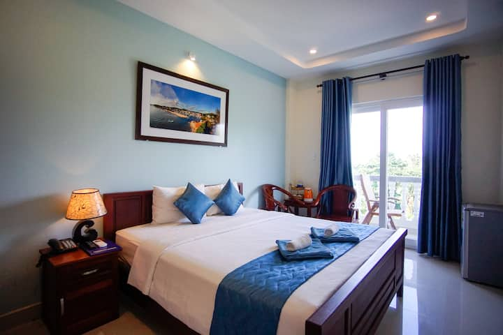 DELUXE ROOM WITH BALCONY AT BRENTA PHU QUOC HOTEL