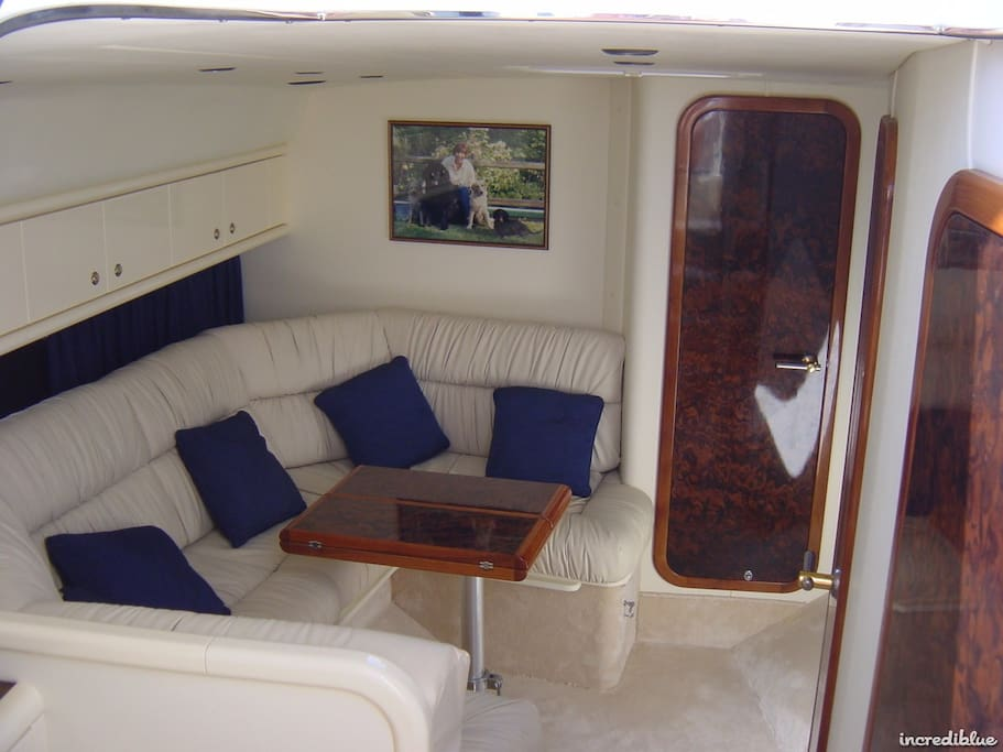 Main Cabin/Saloon consisting of large dinette with telescopic table converting to double birth.