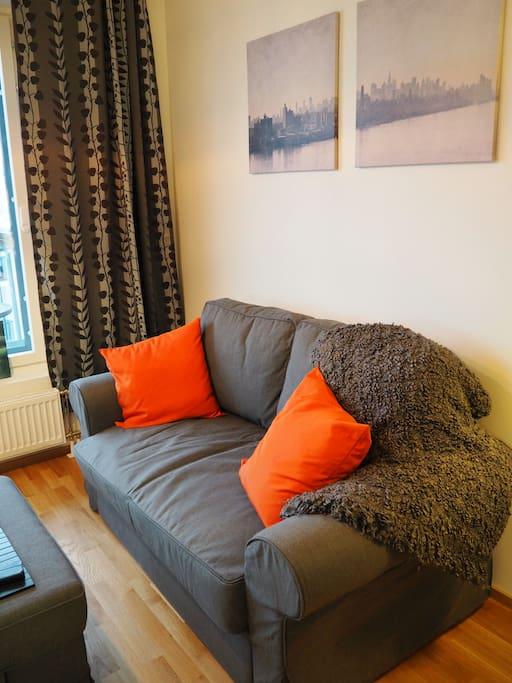 The comfy sofa is convertible. // Mukava sohva avautuu myös vuoteeksi.