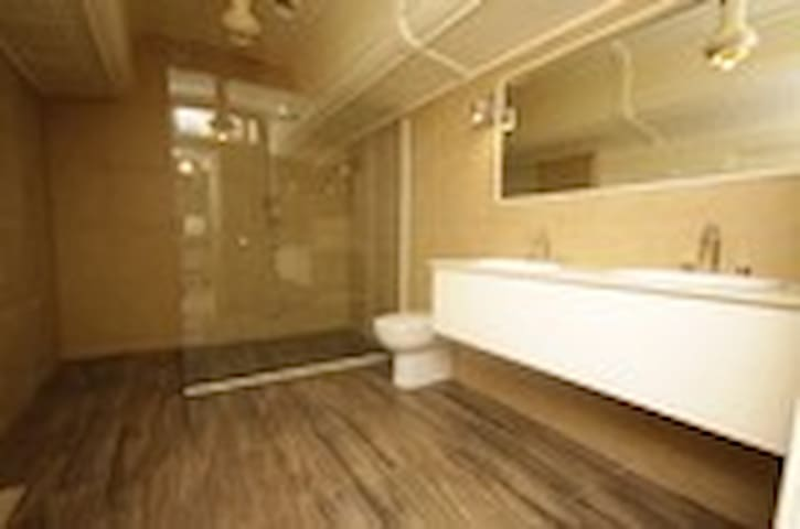 Luxurious ensuite with spacious shower and double vanity