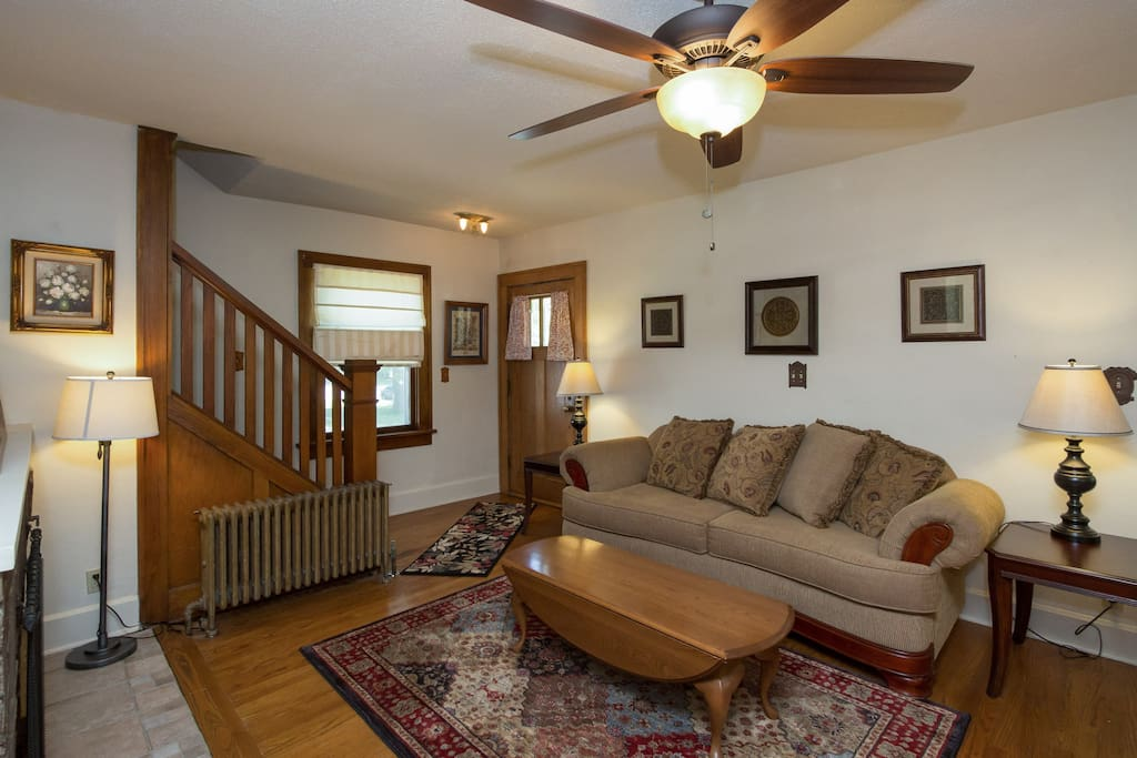Large living room with comfortable furniture and hardwood floors.