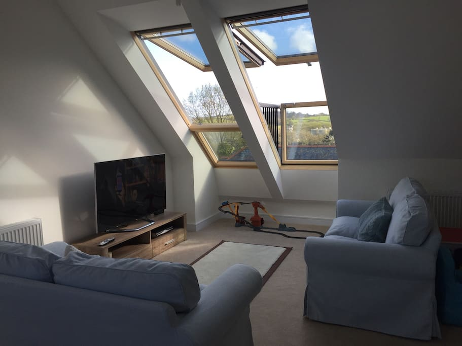 Living room with balconied velux Windows giving incredible views over surrounding countryside and estuary