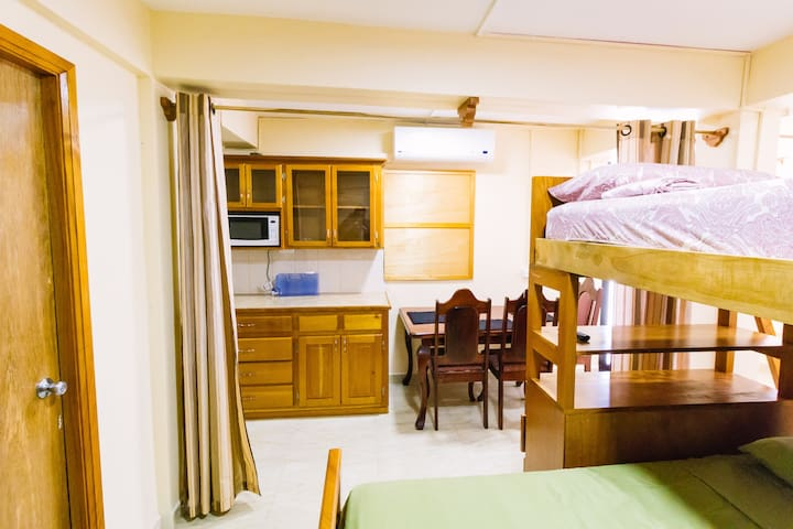 Bed, looking into Kitchenette