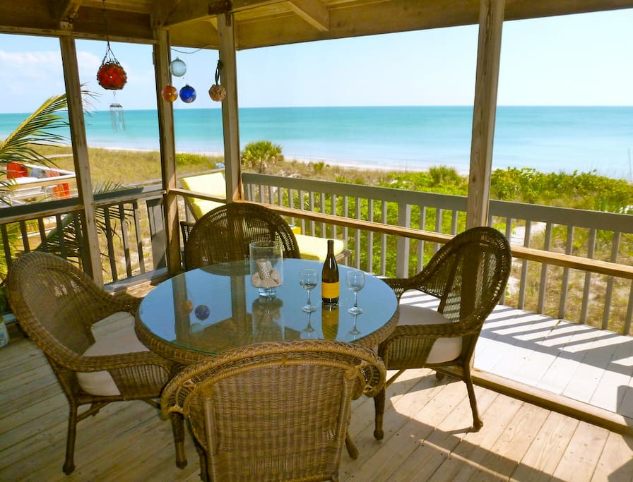 Front porch dining area offers fabulous beach views