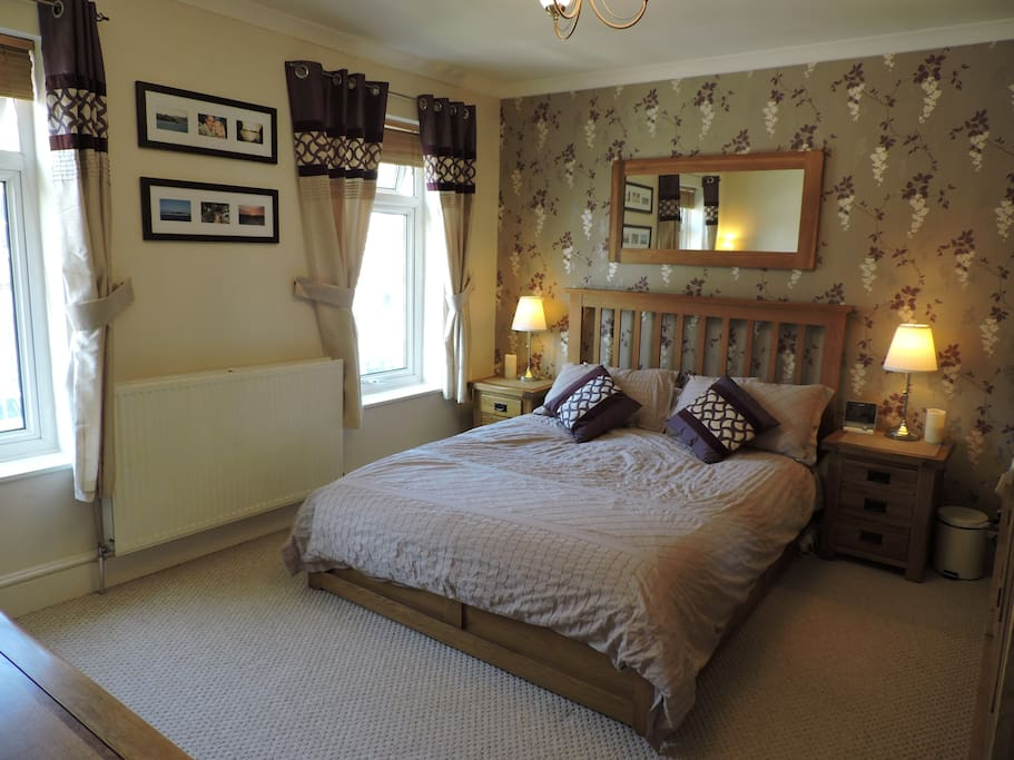 Master bedroom. King size bed and plenty of storage.
