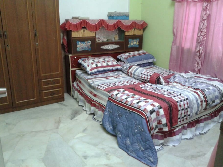 Room 1 (Master bedroom) - queen bed, ceiling fan, toilet/bathroom, cupboard.