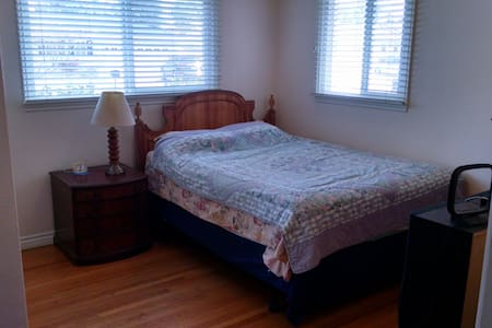 A comfortable bed in remodeled home - Santa Ana