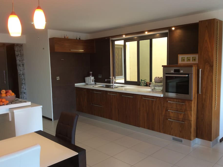 The kitchen is equipped with refrigerator, micro-wave oven, gas cooker, oven,toaster, an iron