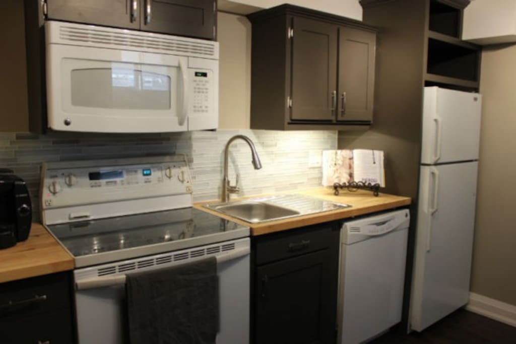 New custom kitchen with diswasher.  All utensils, plates, etc. included