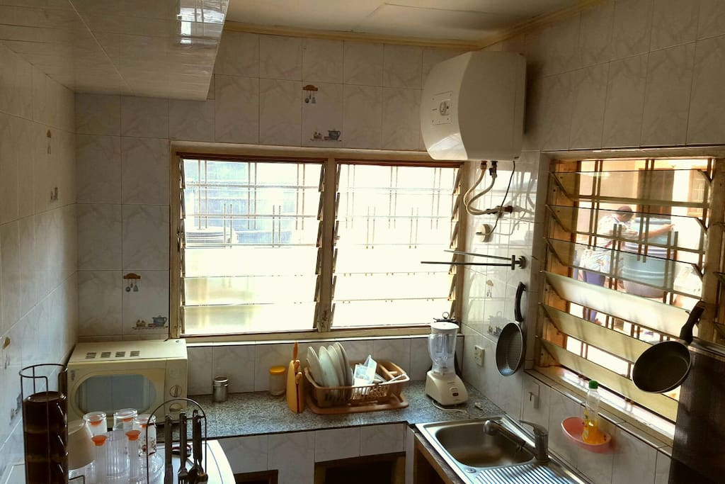 private kitchen equipped with fridge,cooker,microwave blender and cooking utensils