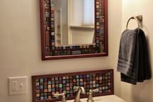 Artistic mirror & backsplash in bathroom