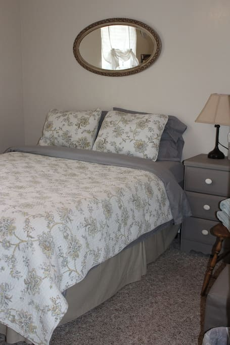 Comfortable Queen sized bed with memory foam topper