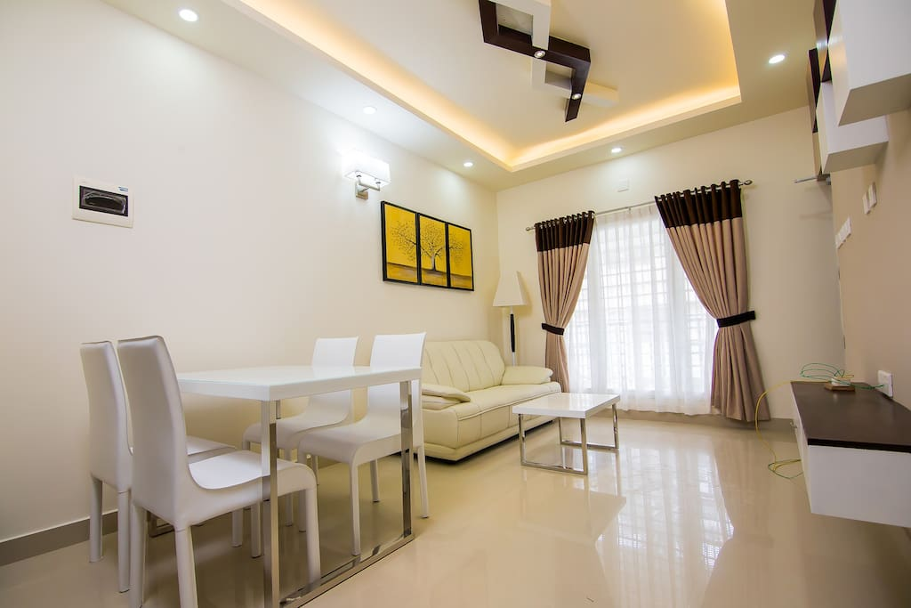 Spacious hall with 32″ LED HD TV, 100+ channels, Dinging and modern furnitures