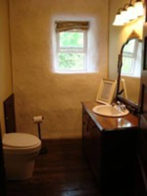 The upstairs toilet room.