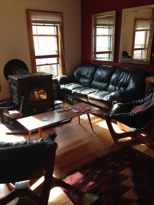 Sunlit living room, wood stove