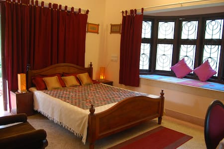 Sourabham Homestay - AC Room with a double bed